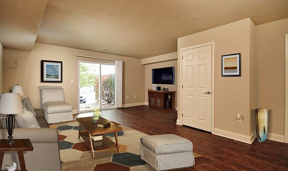 Spacious living room at The Village of Laurel Ridge & The Encore Apartments & Townhomes in Harrisburg, Pennsylvania