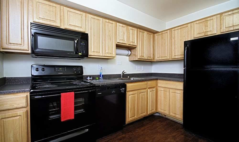 Full-equipped kitchen at The Village of Laurel Ridge & The Encore Apartments & Townhomes in Harrisburg, Pennsylvania