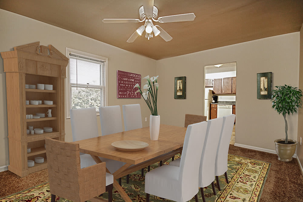 Dining room with a ceiling fan at The Village of Laurel Ridge & The Encore Apartments & Townhomes in Harrisburg, Pennsylvania