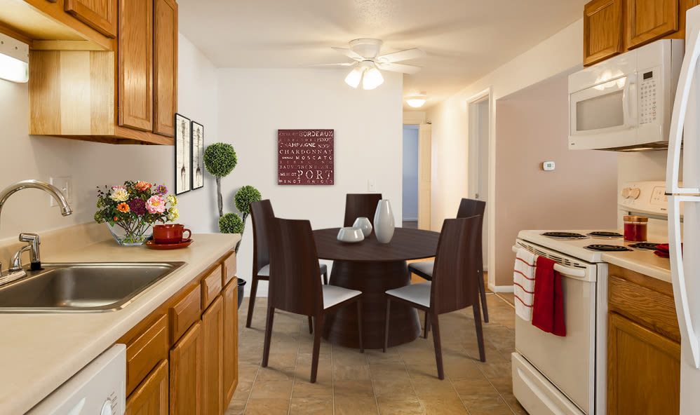 Kitchen and dining table at King's Court Manor Apartments in Rochester, New York