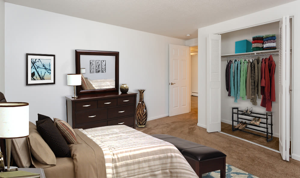 Cozy bedroom at King's Court Manor Apartments in Rochester, New York