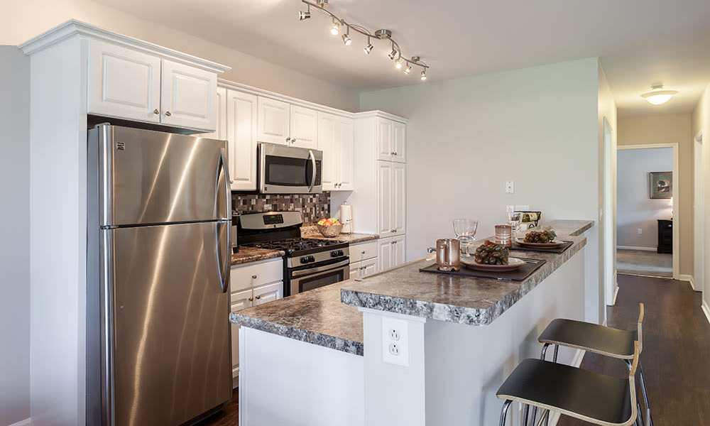 Well-equipped, bright kitchen at Oakmonte Apartments in Webster, New York