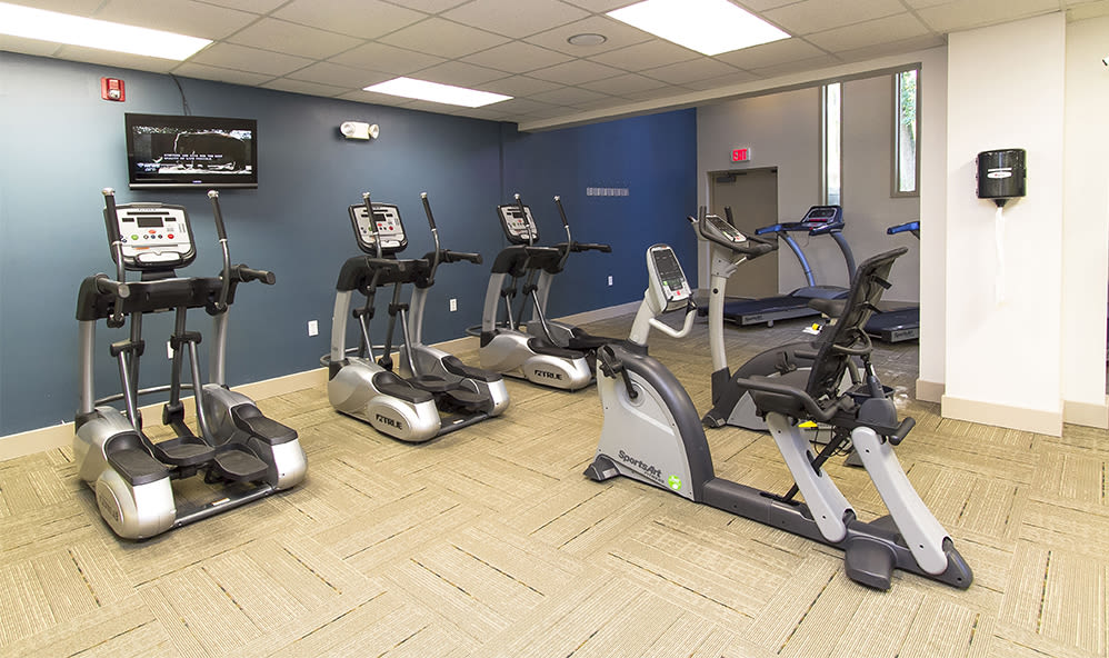 Modern fitness center at Raintree Island Apartments in Tonawanda, New York