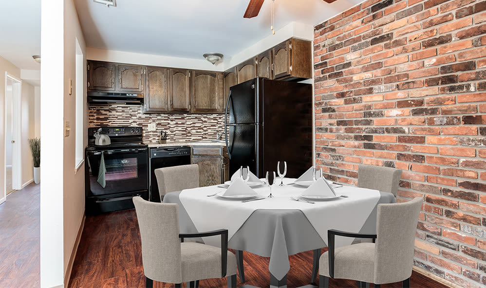 Dining room and kitchen at Raintree Island Apartments in Tonawanda, New York