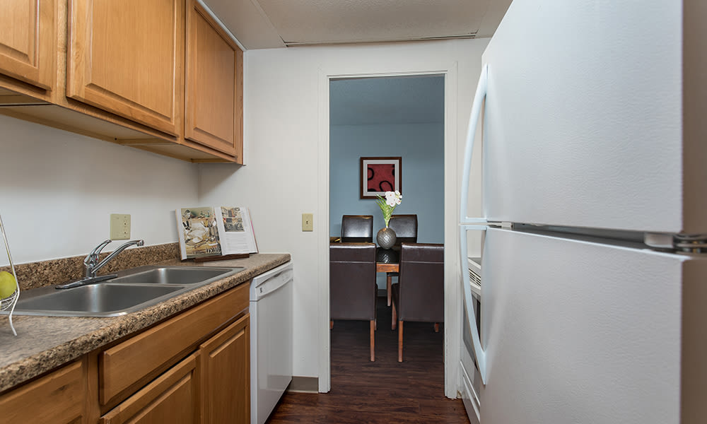 Bright, fully-equipped kitchen at Park Guilderland Apartments in Guilderland Center, New York