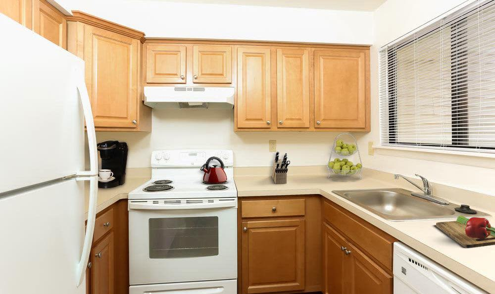 Bright, well-equipped kitchen at Penbrooke Meadows in Penfield, New York