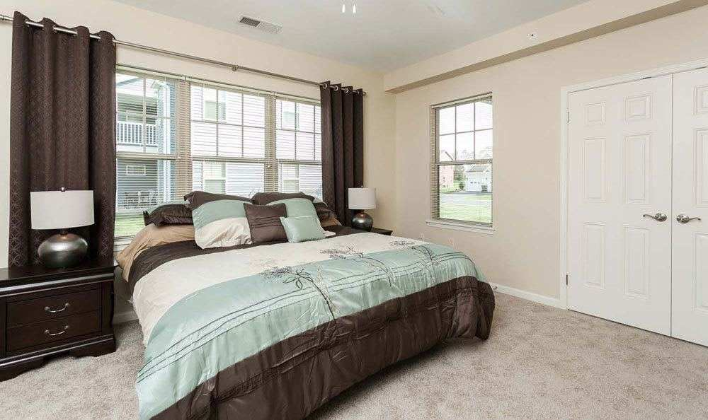 Cozy bedroom at Saratoga Crossing in Farmington, New York