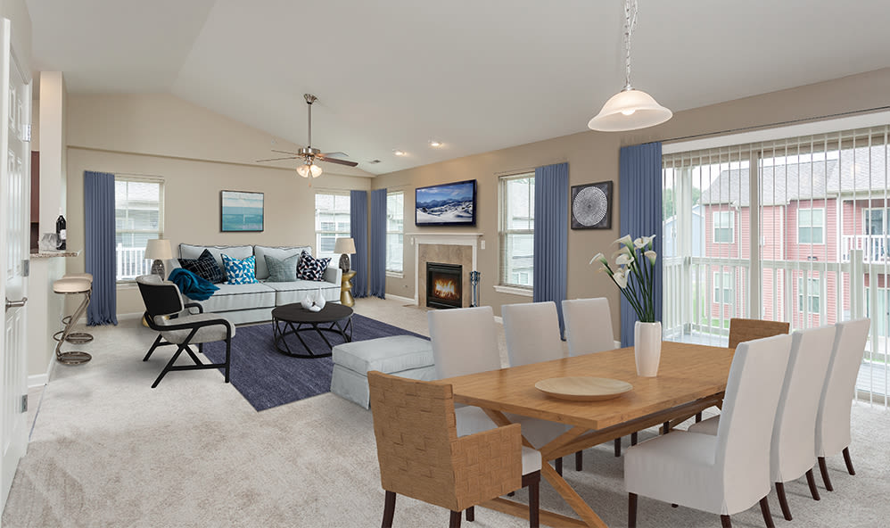 Living room and dining table at Saratoga Crossing in Farmington, New York