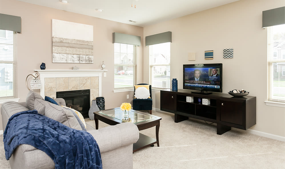 Cozy living room at Saratoga Crossing in Farmington, New York