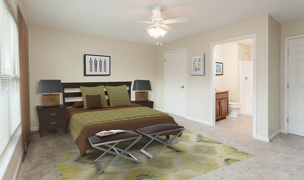 Well-lit bedroom at Saratoga Crossing in Farmington, New York