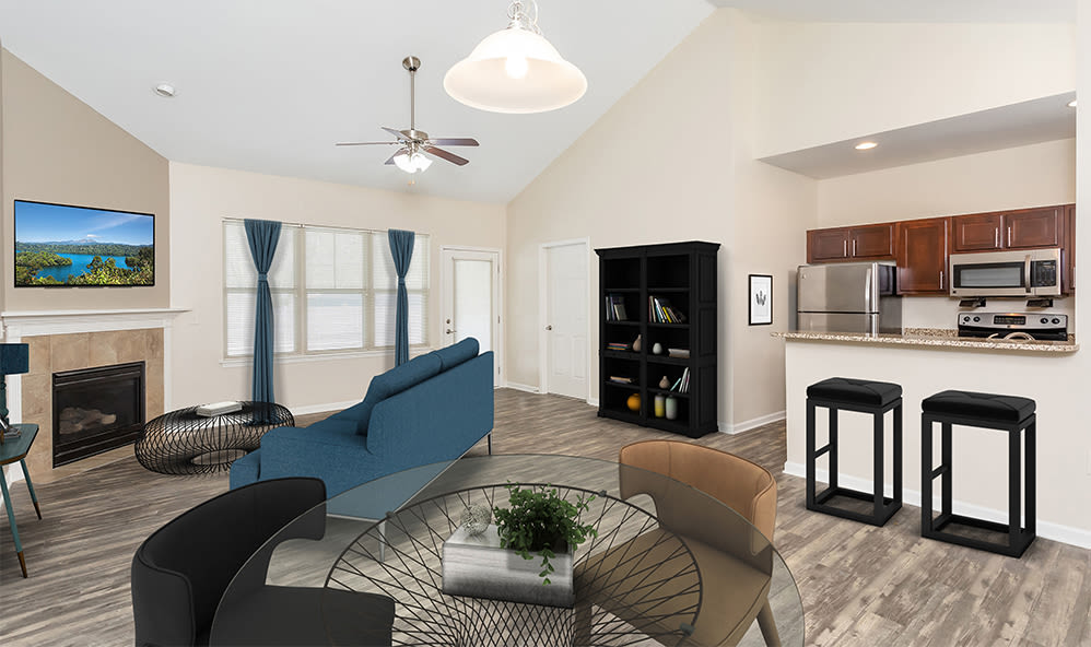 Spacious, bright living room at Saratoga Crossing in Farmington, New York