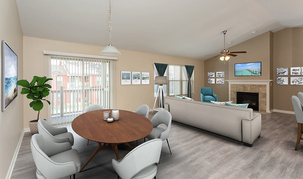 Living room with patio access at Saratoga Crossing in Farmington, New York