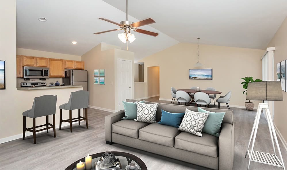 Living room with a ceiling fan at Saratoga Crossing in Farmington, New Yorkj