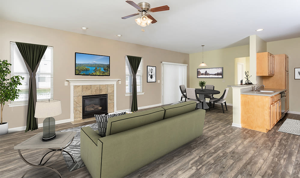 Natrually well-lit living room at Saratoga Crossing in Farmington, New York
