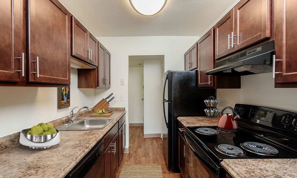Fully-equipped kitchen at The Meadows Apartments in Syracuse, New York