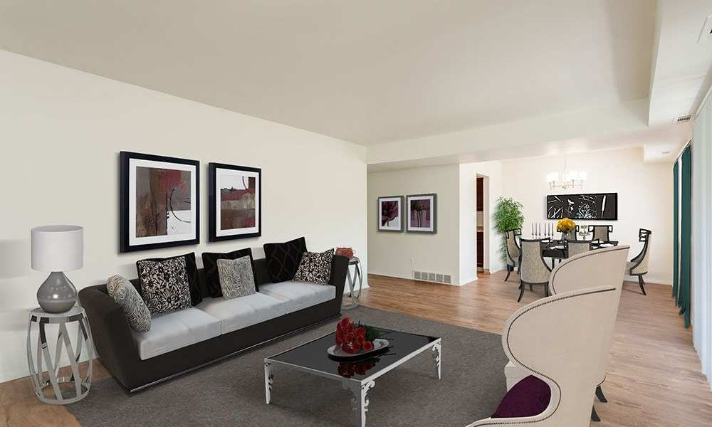 Spacious living room at The Meadows Apartments in Syracuse, New York