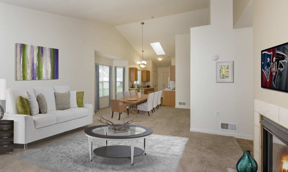 Spacious living room at Regency & Victor Villas Apartments in Victor, New York