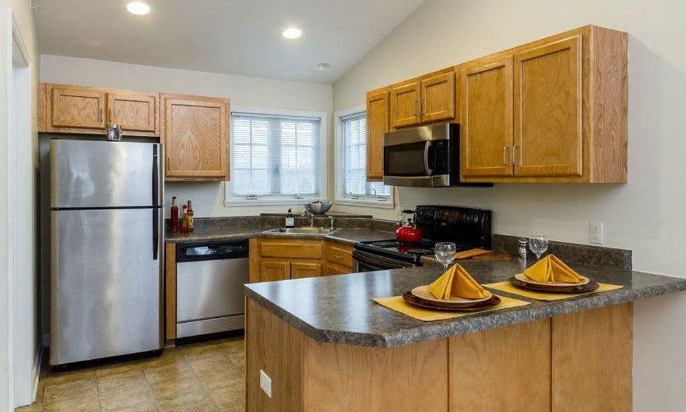 Fully-equipped kitchen at Regency & Victor Villas Apartments in Victor, New York
