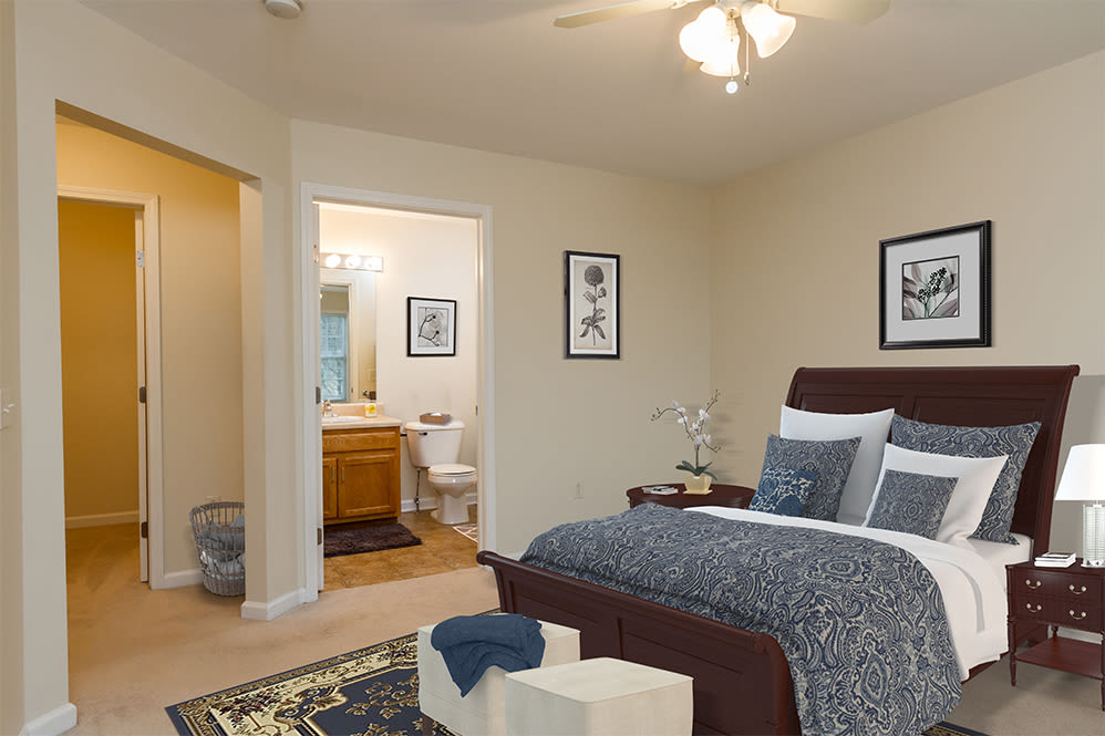 Regency & Victor Villas Apartments in Victor, New York have a cozy bedroom