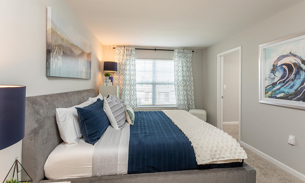 Cozy bedroom at Woodland Acres Townhomes in Liverpool, New York