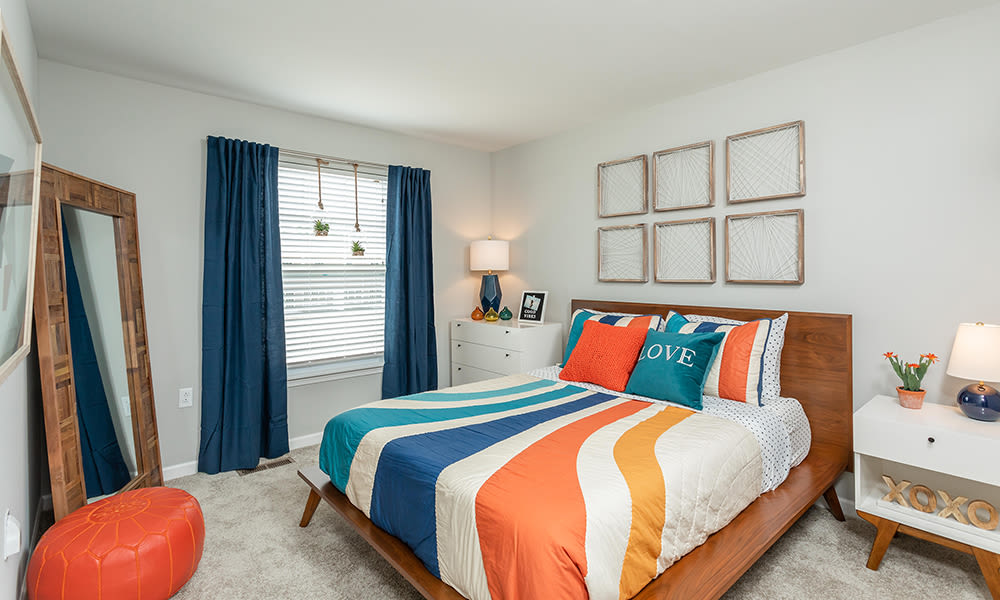 Bright, spacious bedroom at Woodland Acres Townhomes in Liverpool, New York