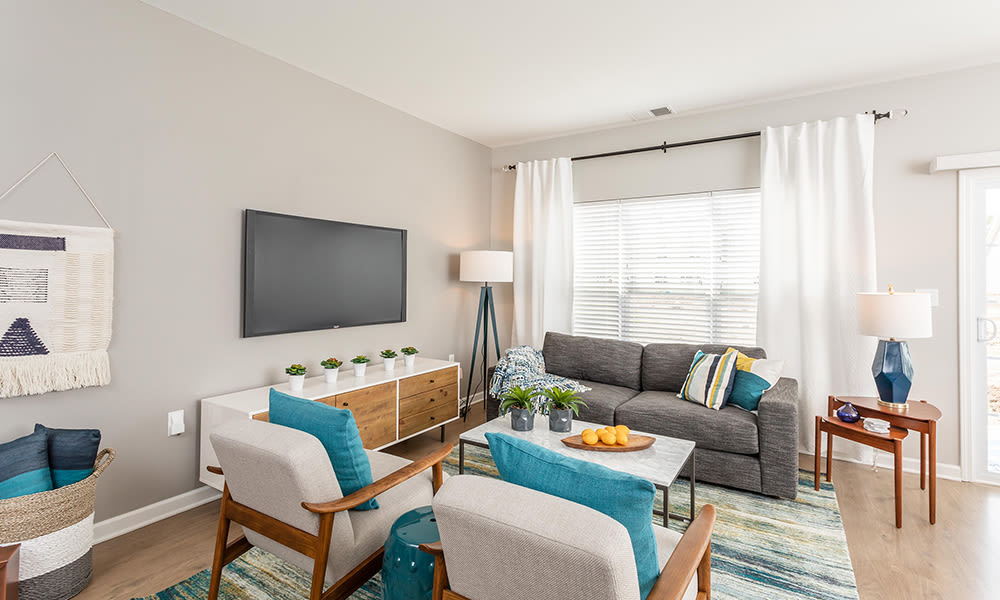 Naturally well-lit living room at Woodland Acres Townhomes in Liverpool, New York