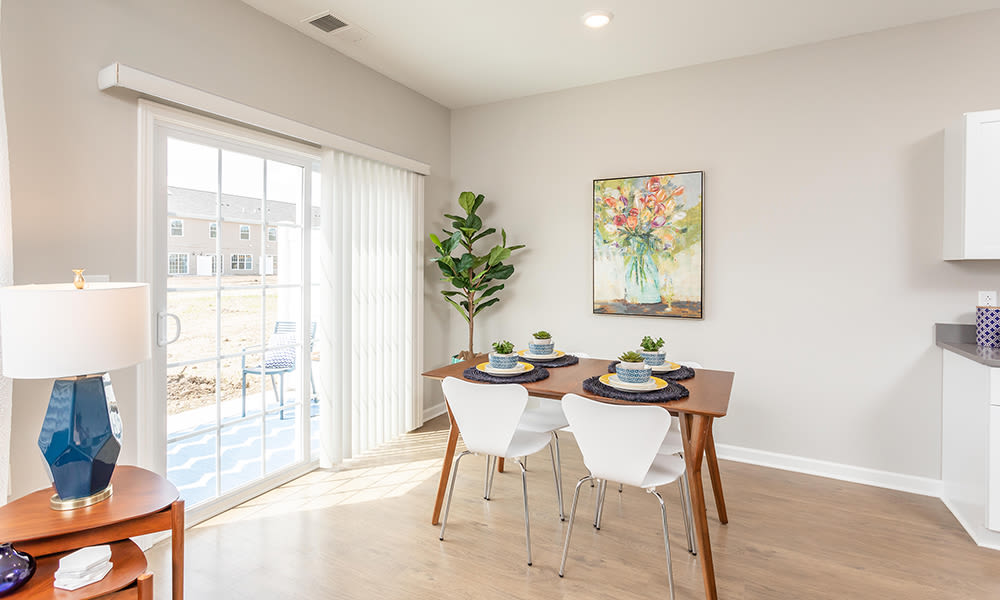 Spacious dining room area at Woodland Acres Townhomes in Liverpool, New York