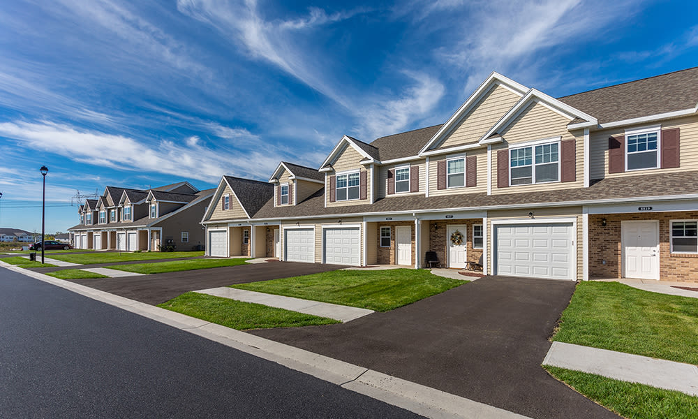 Townhomes with garages at Woodland Acres Townhomes in Liverpool, New York