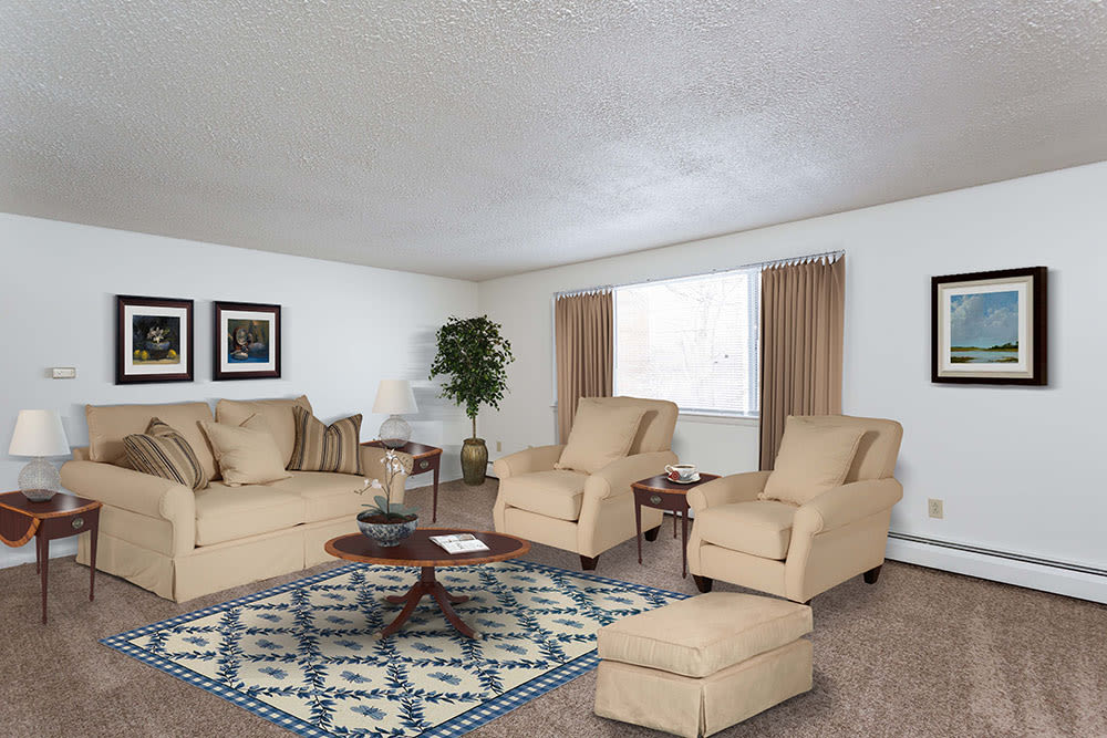 Luxury living room at Perinton Manor Apartments in Fairport, New York