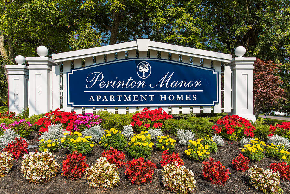 Sign to Perinton Manor Apartments in Fairport, New York
