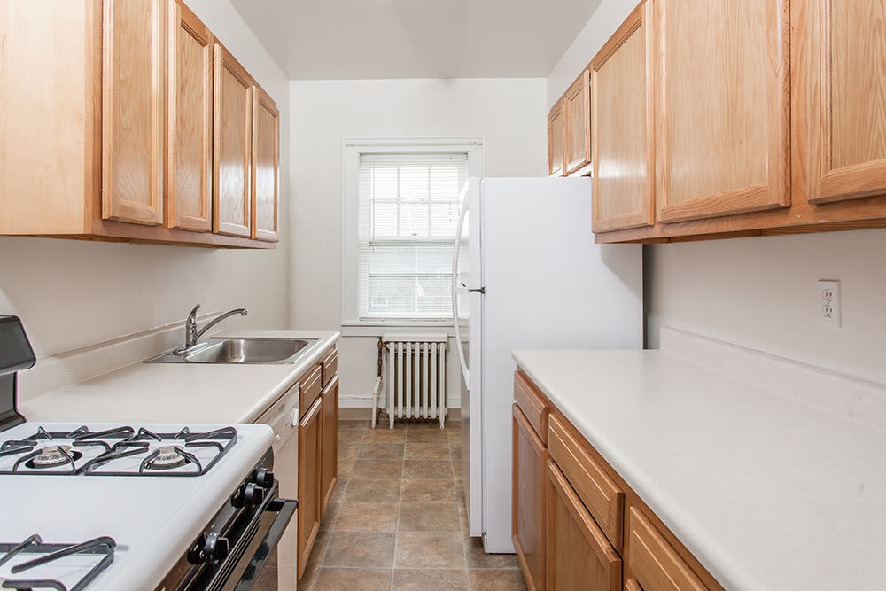 Galley kitchen in apartment at Barrington Apartments in Rochester, New York