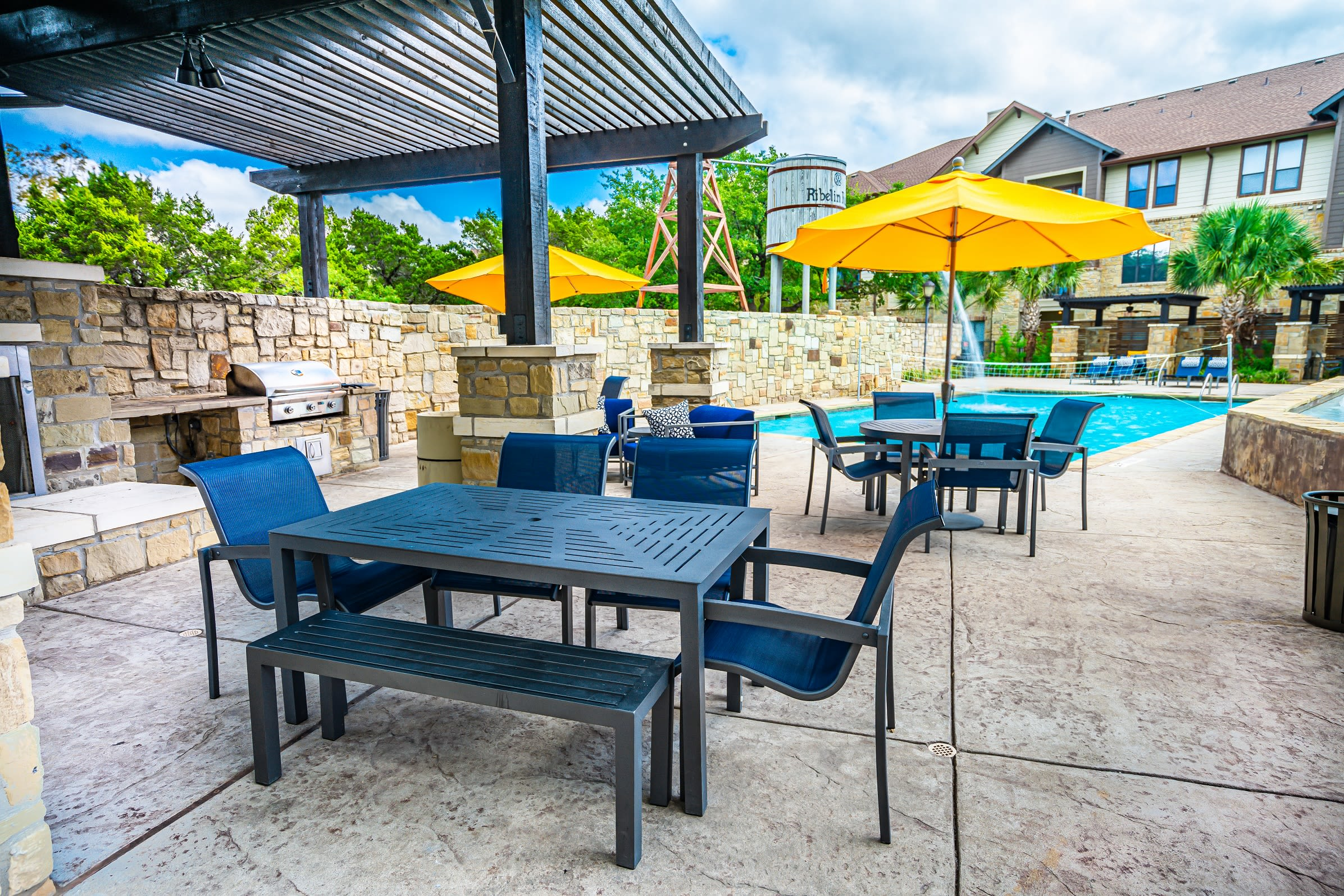 Poolside BBQ and seating at The Asten at Ribelin Ranch in Austin, Texas