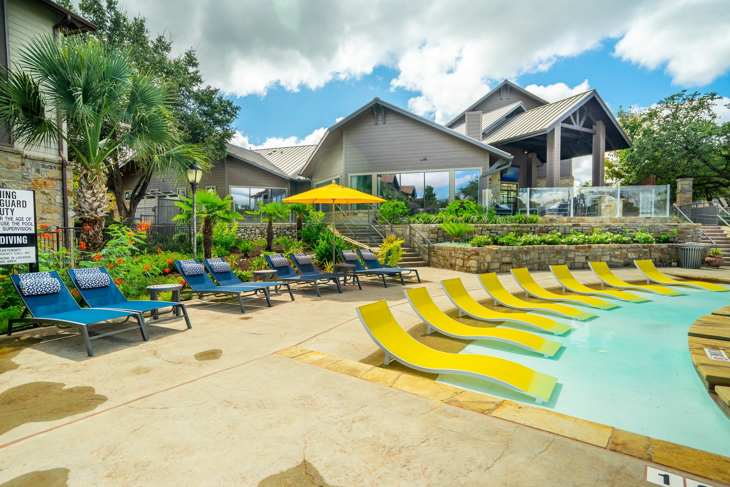 Poolside lounge chairs at The Asten at Ribelin Ranch in Austin, Texas