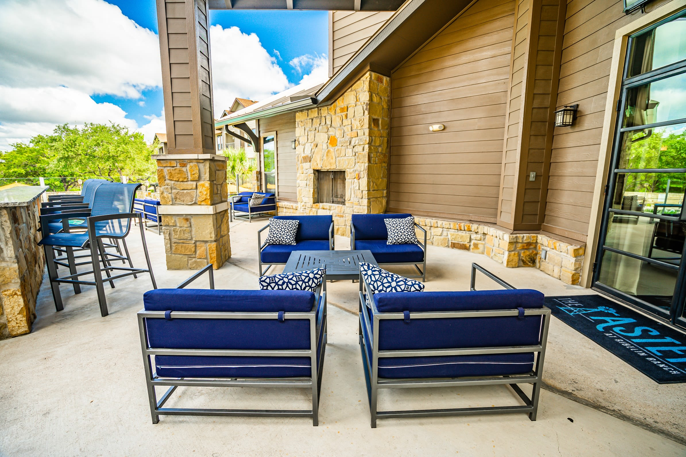 Lounge chairs on deck near pool at The Asten at Ribelin Ranch in Austin, Texas