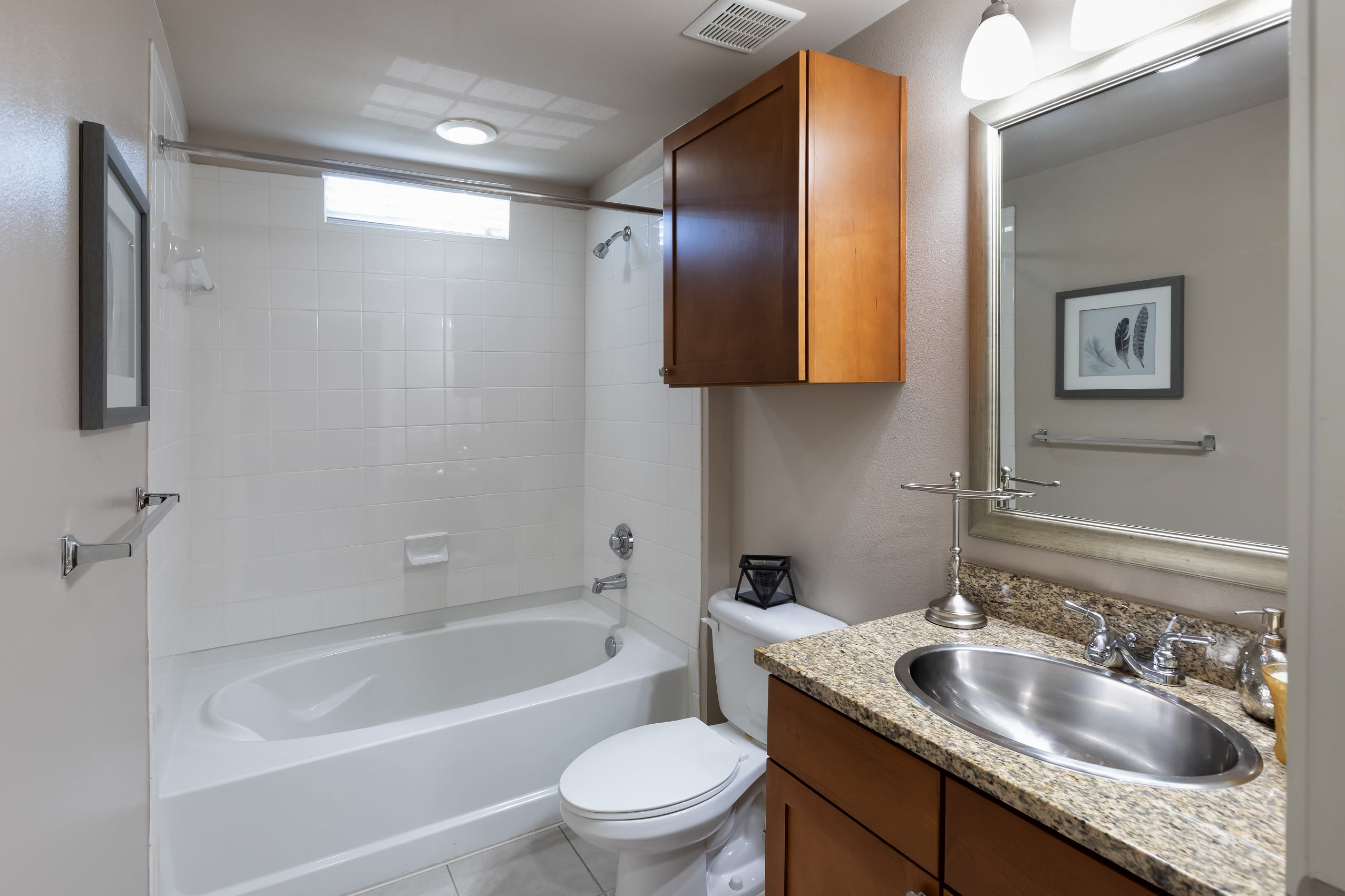 Spacious master bathroom with a large vanity mirror at Lakefront Villas in Houston, Texas