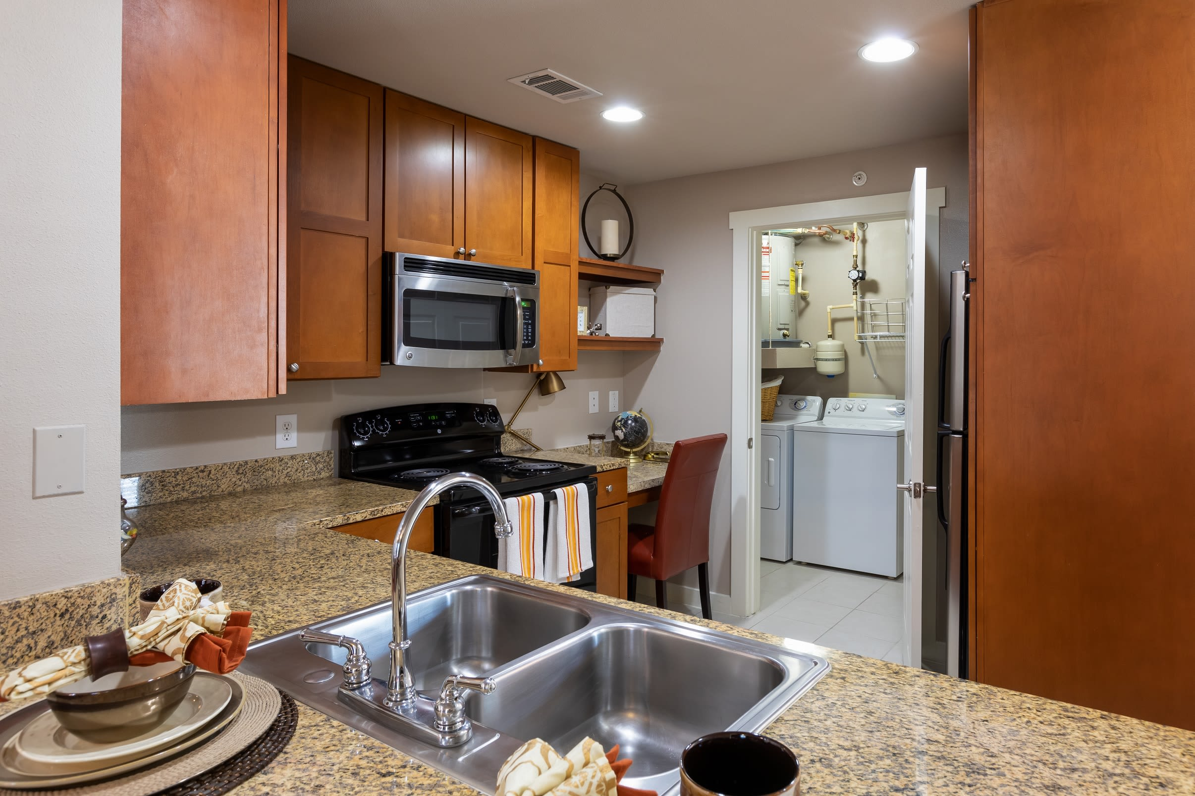 Kitchen with granite countertops at Lakefront Villas in Houston, Texas