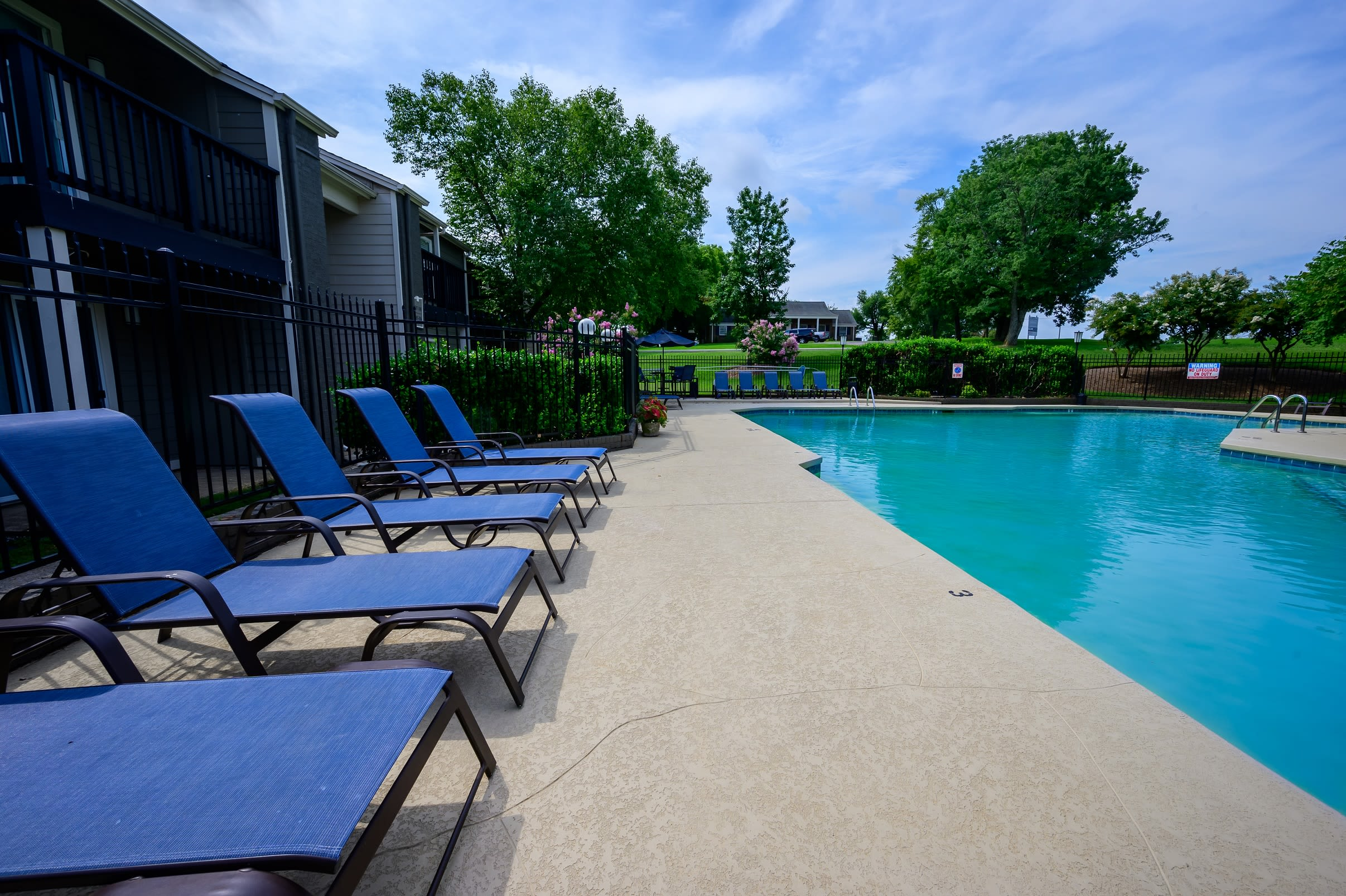 Resort-style swimming pool with a sundeck and lounge chairs at The Hamilton in Hendersonville, Tennessee
