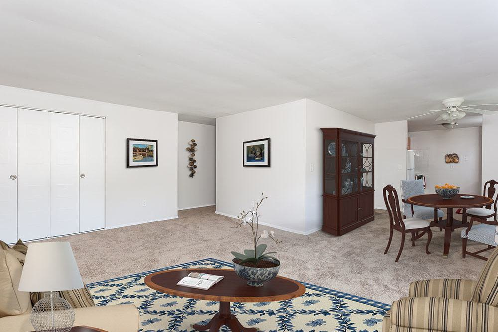 Spacious living room at Long Pond Gardens Senior Apartments in Rochester, New York