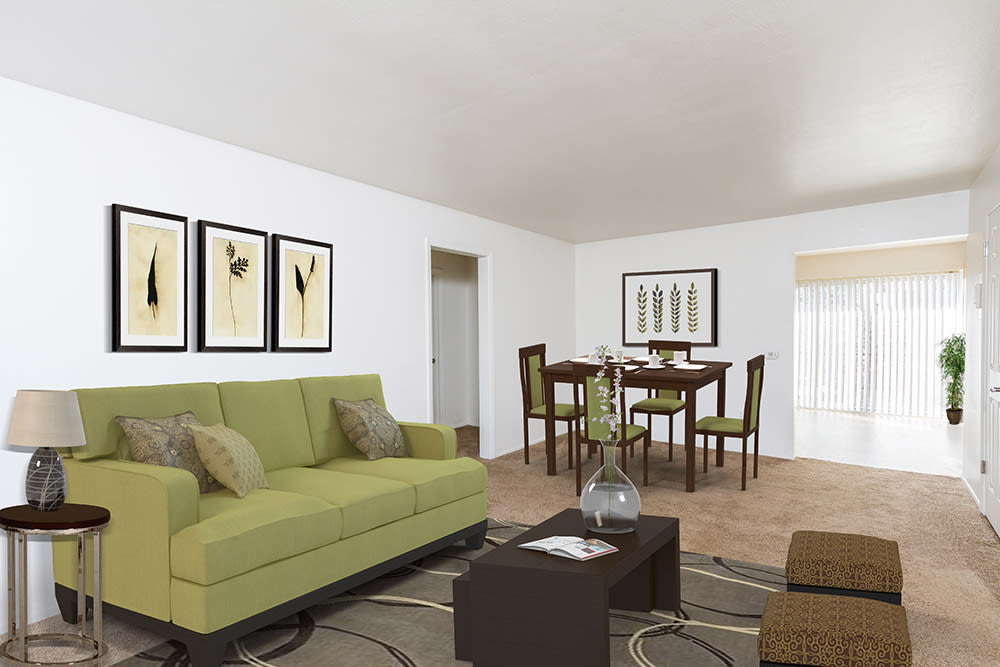 Well decorated living room at Pittsford Garden Apartments in Pittsford, New York