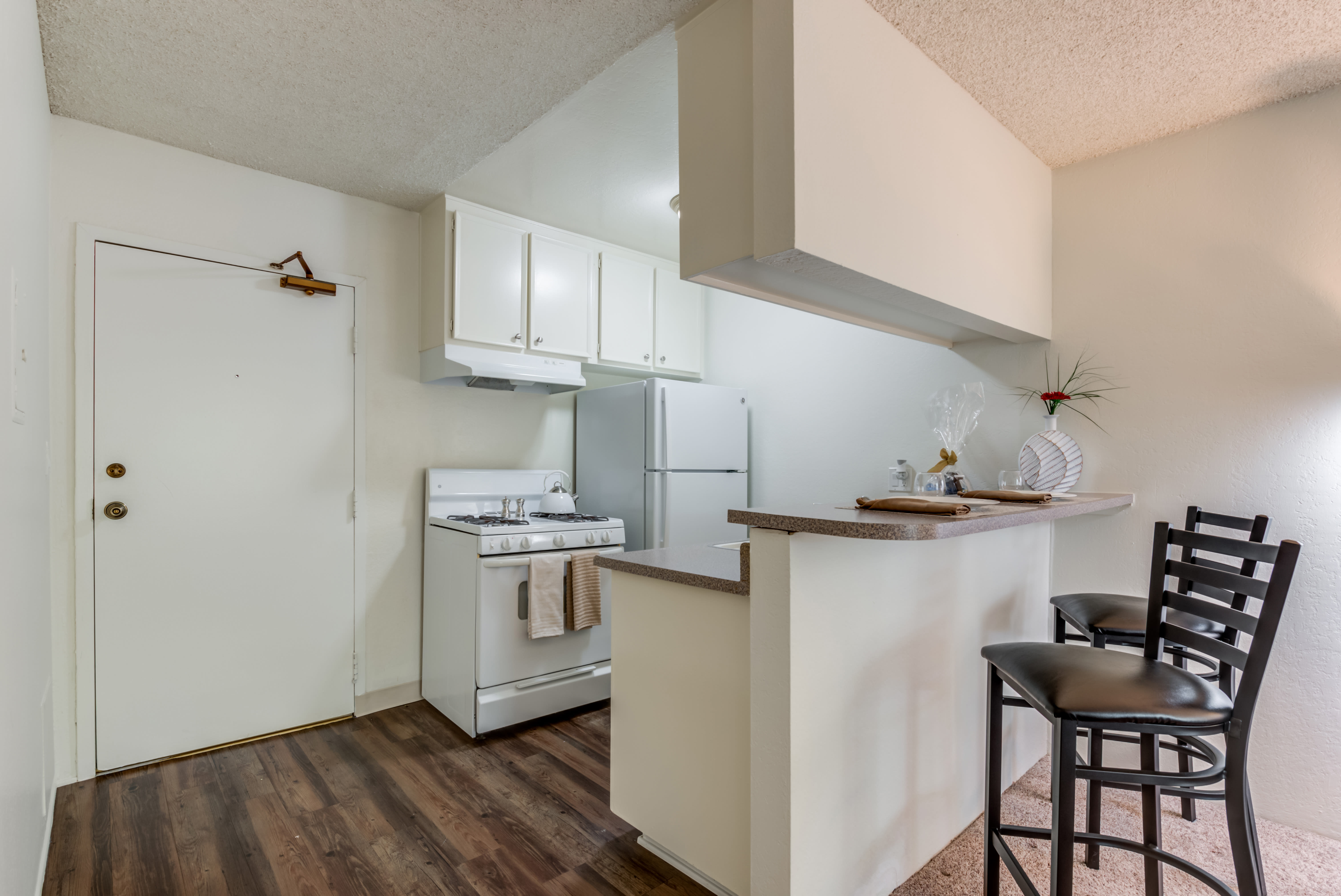 Kitchen with wood style floor and breakfast bar at Vista Pointe I in Studio City, California