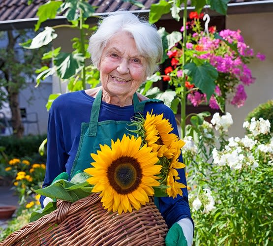 One of our residents here at Grand Villa of Sarasota tending to her garden at our community in Florida