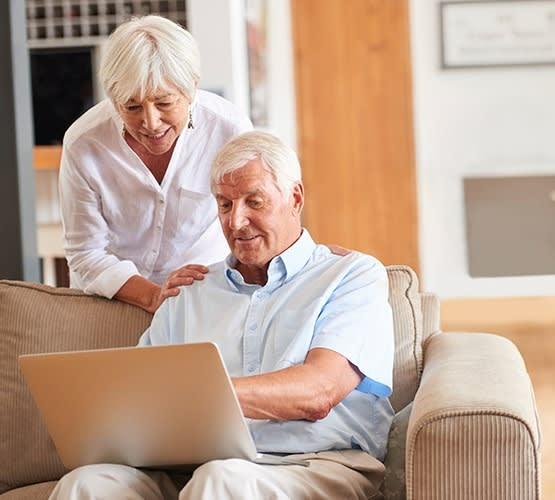 A couple looking at a computer at Grand Villa of Sarasota in Sarasota, Florida