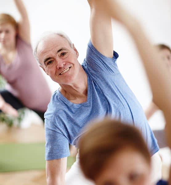 Senior man exercising in one of the many classes offered at Grand Villa of Sarasota in Sarasota, Florida
