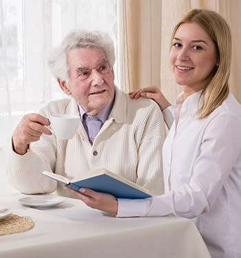 Nurse helping a Grand Villa of Sarasota resident at our senior living community here in Sarasota
