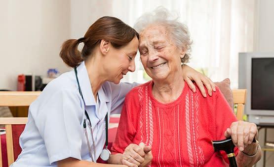 Nurse assisting an elderly woman at Grand Villa of Sarasota in Sarasota, Florida