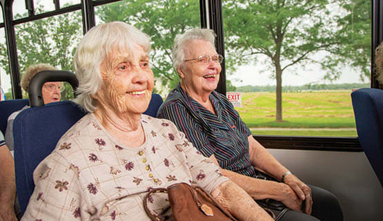 Residents of The Heritage at Fountain Point in Norfolk, Nebraska on the community bus