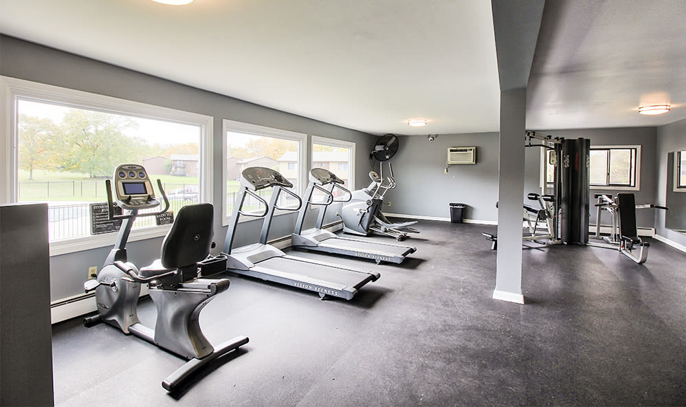 Modern fitness center at High Acres Apartments & Townhomes in Syracuse, New York