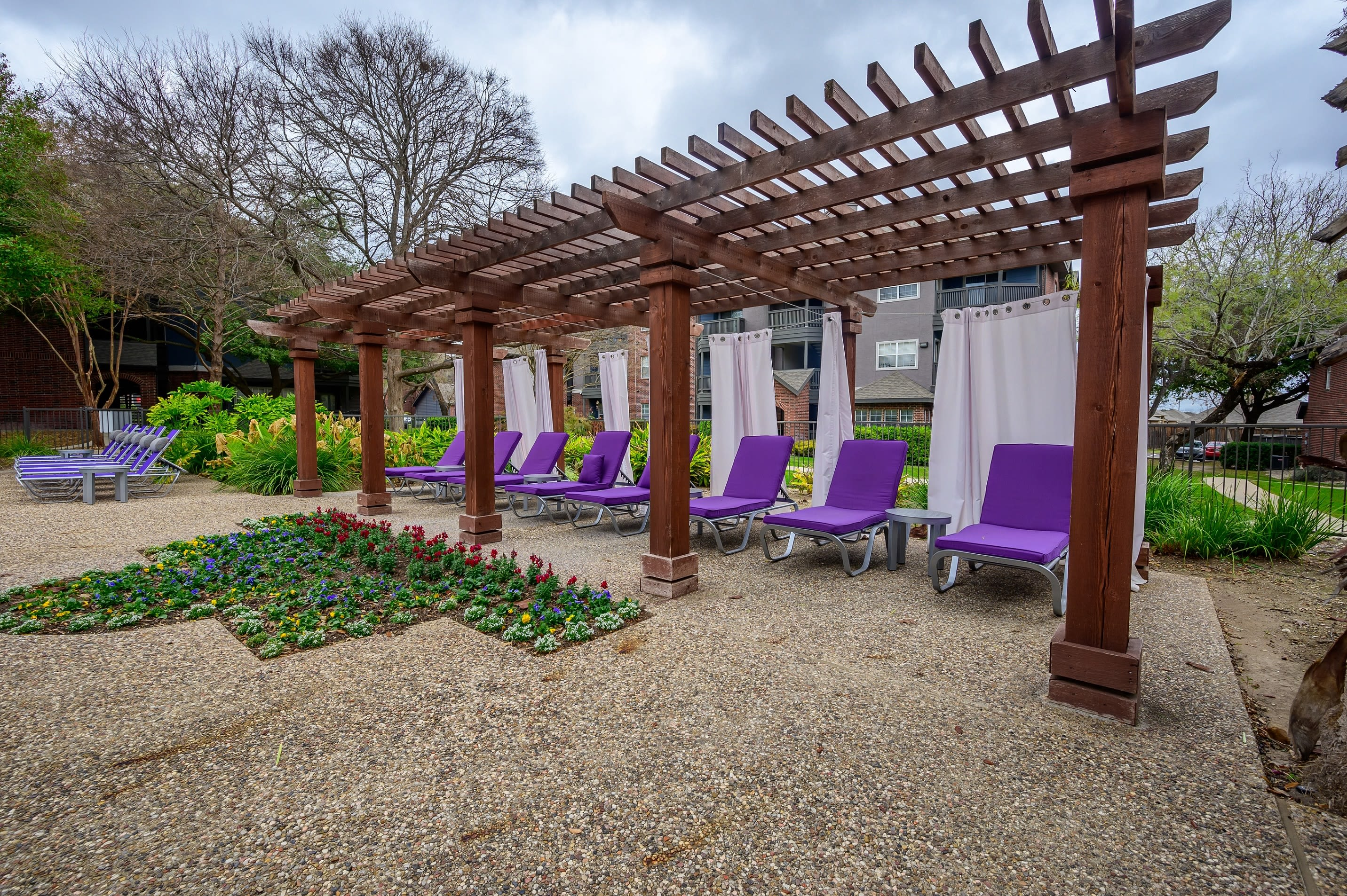 Outdoor lounge chairs with cushions at Alon at Castle Hills in San Antonio, Texas