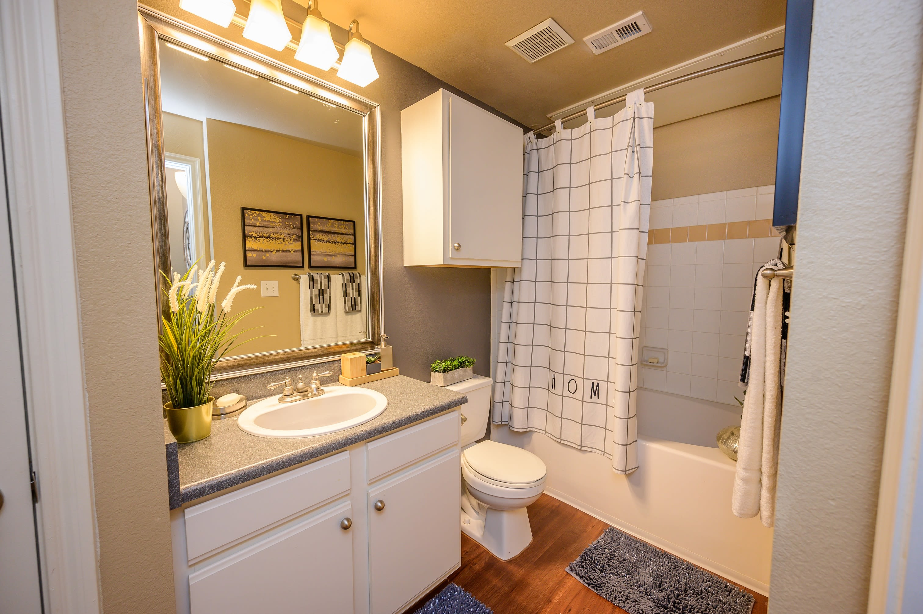 Luxurious bathroom with tub at Alon at Castle Hills in San Antonio, Texas