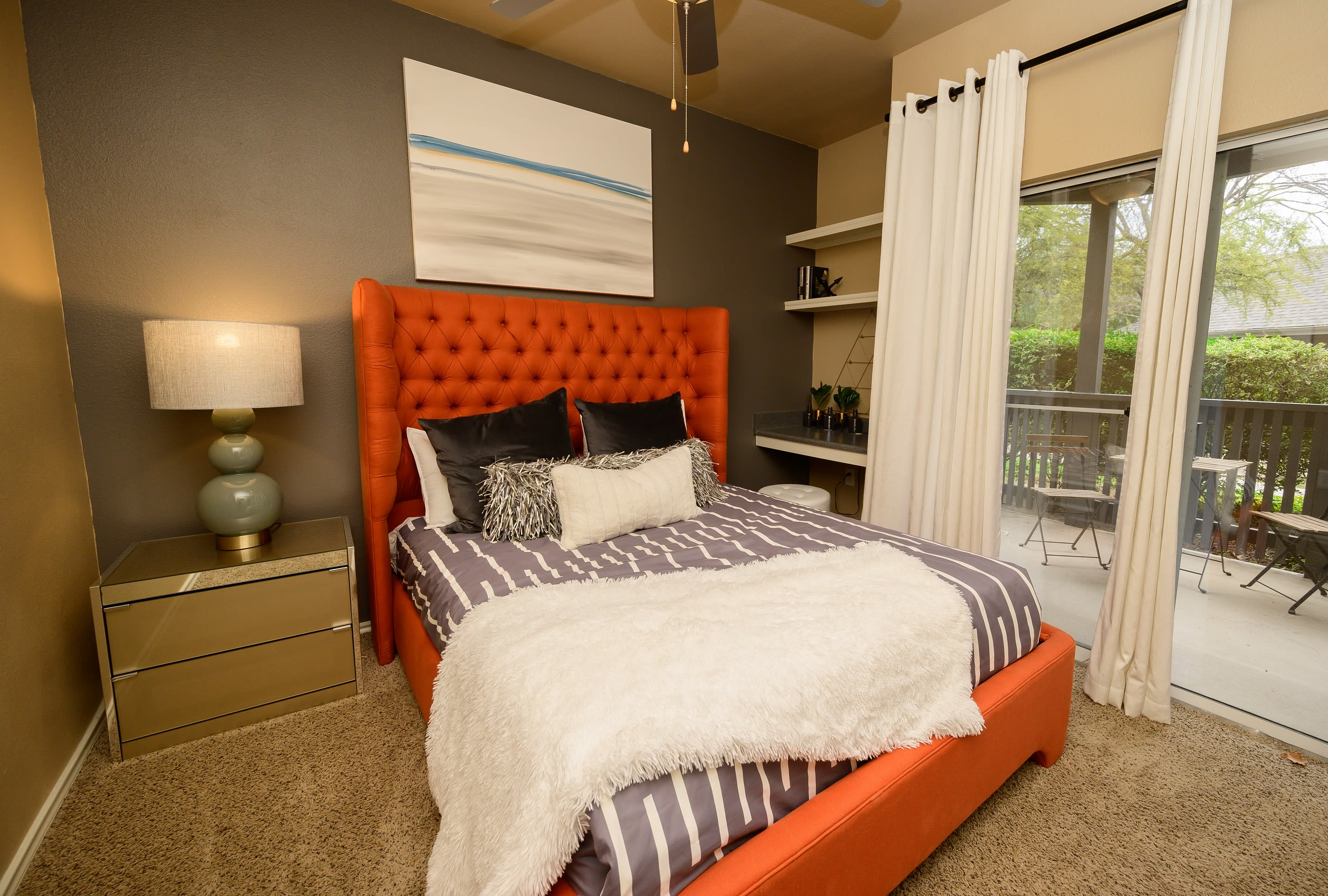 Large main bedroom with private patio access at Alon at Castle Hills in San Antonio, Texas